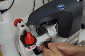 Car key cutting by auto locksmith